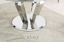 Circular 130 cm marble dining table with chrome stainless steel angular base